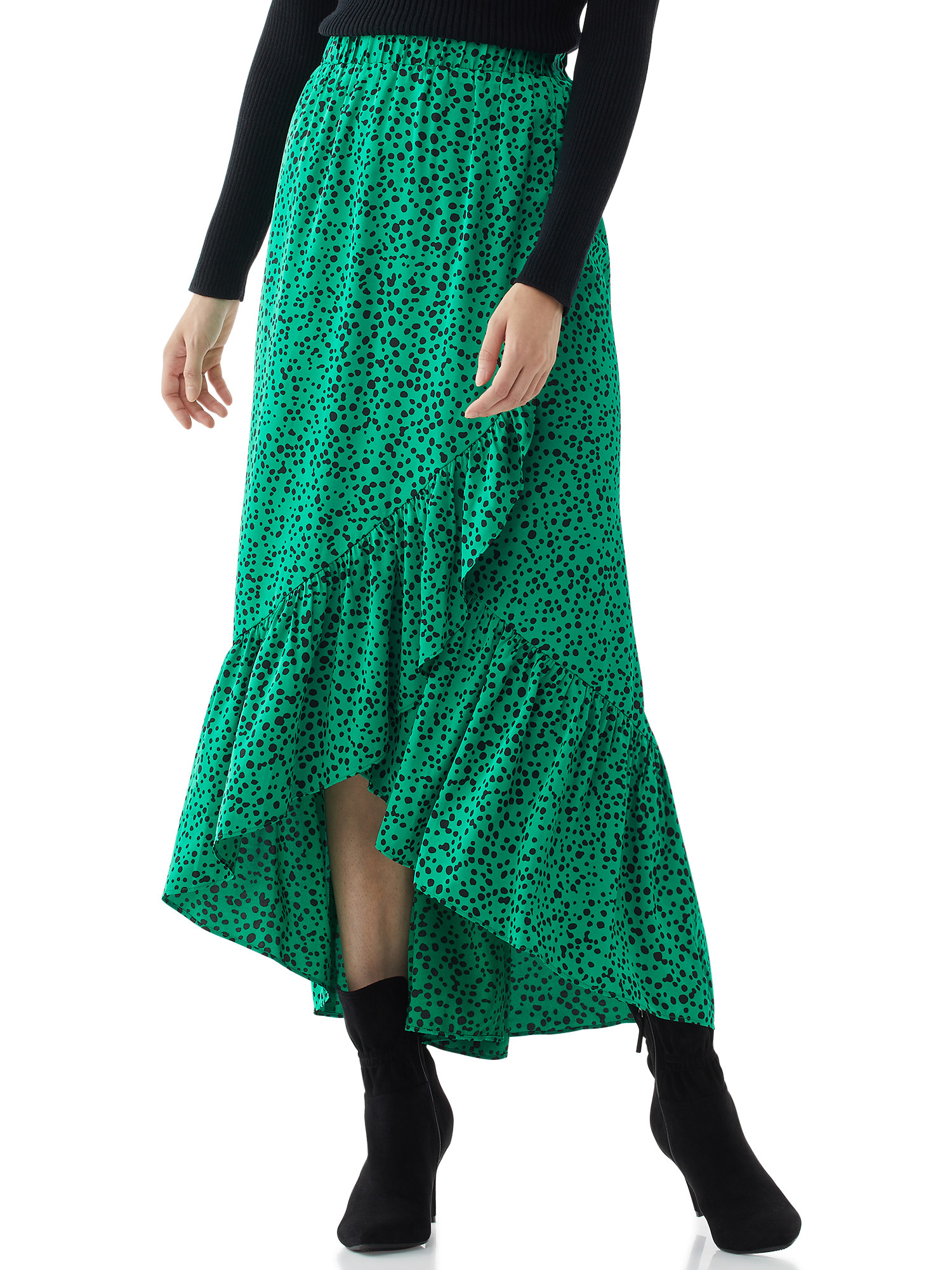 Model in the green and black dotted dress