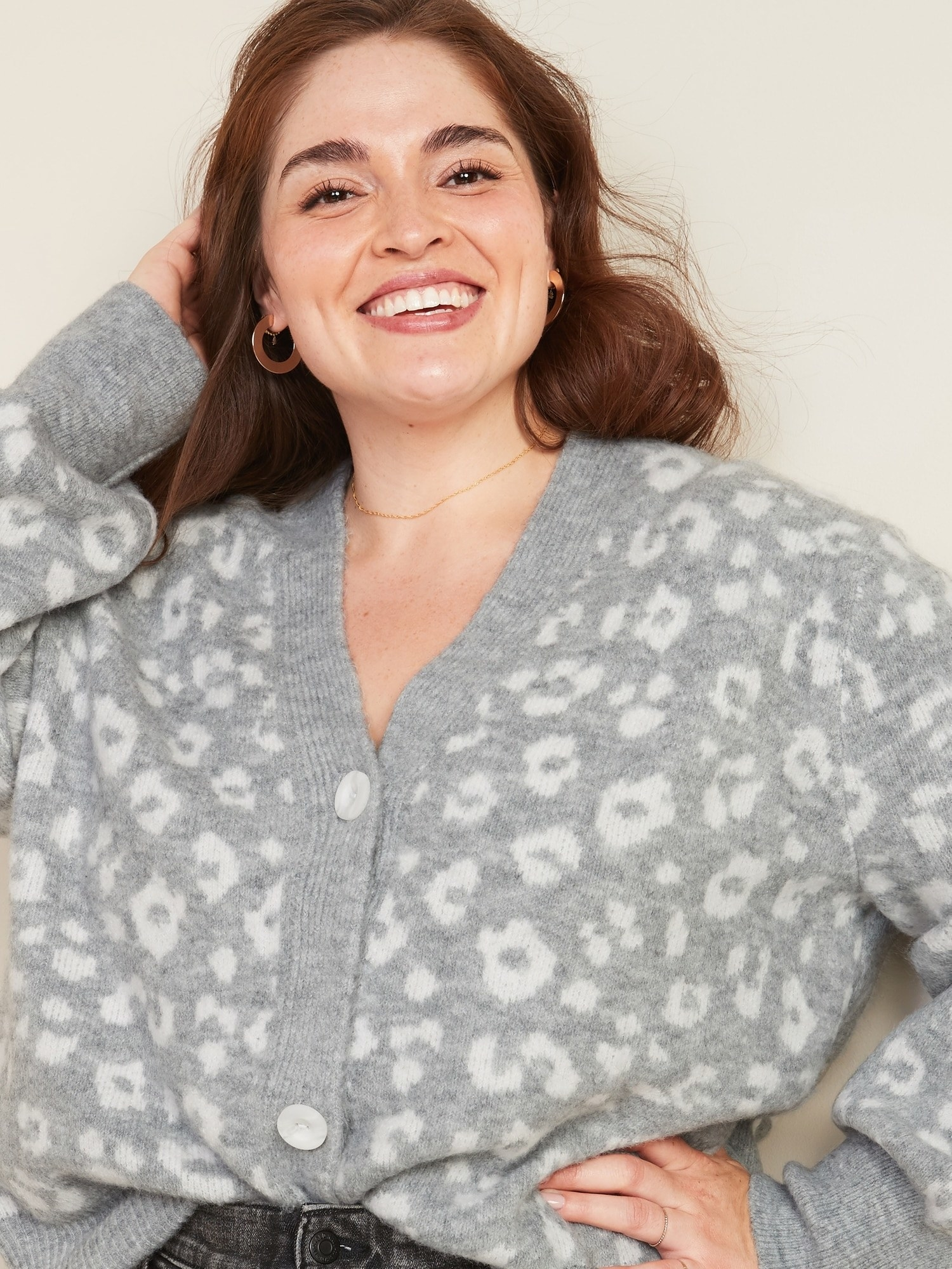 a model in the grey leopard print sweater