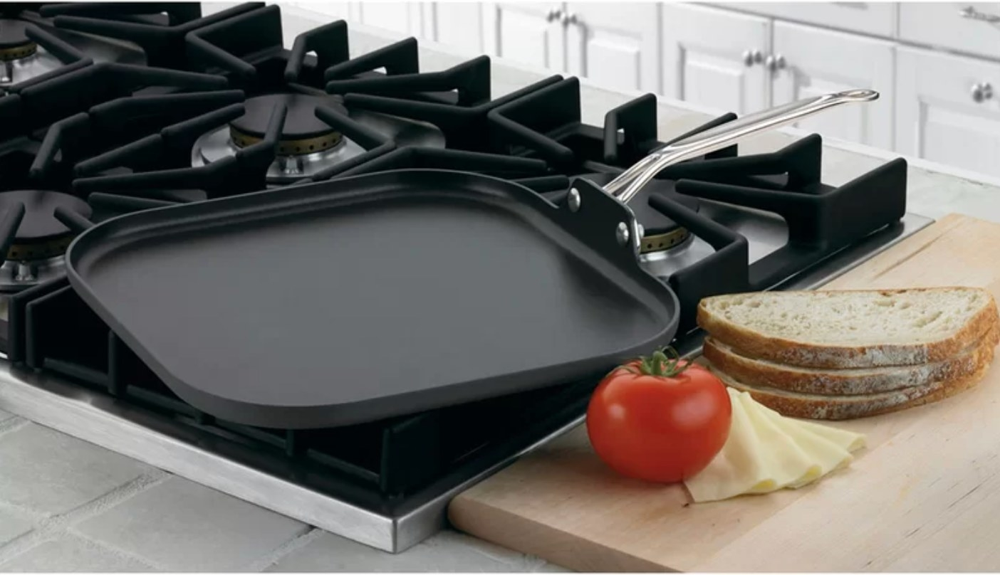 The griddle with a silver handle