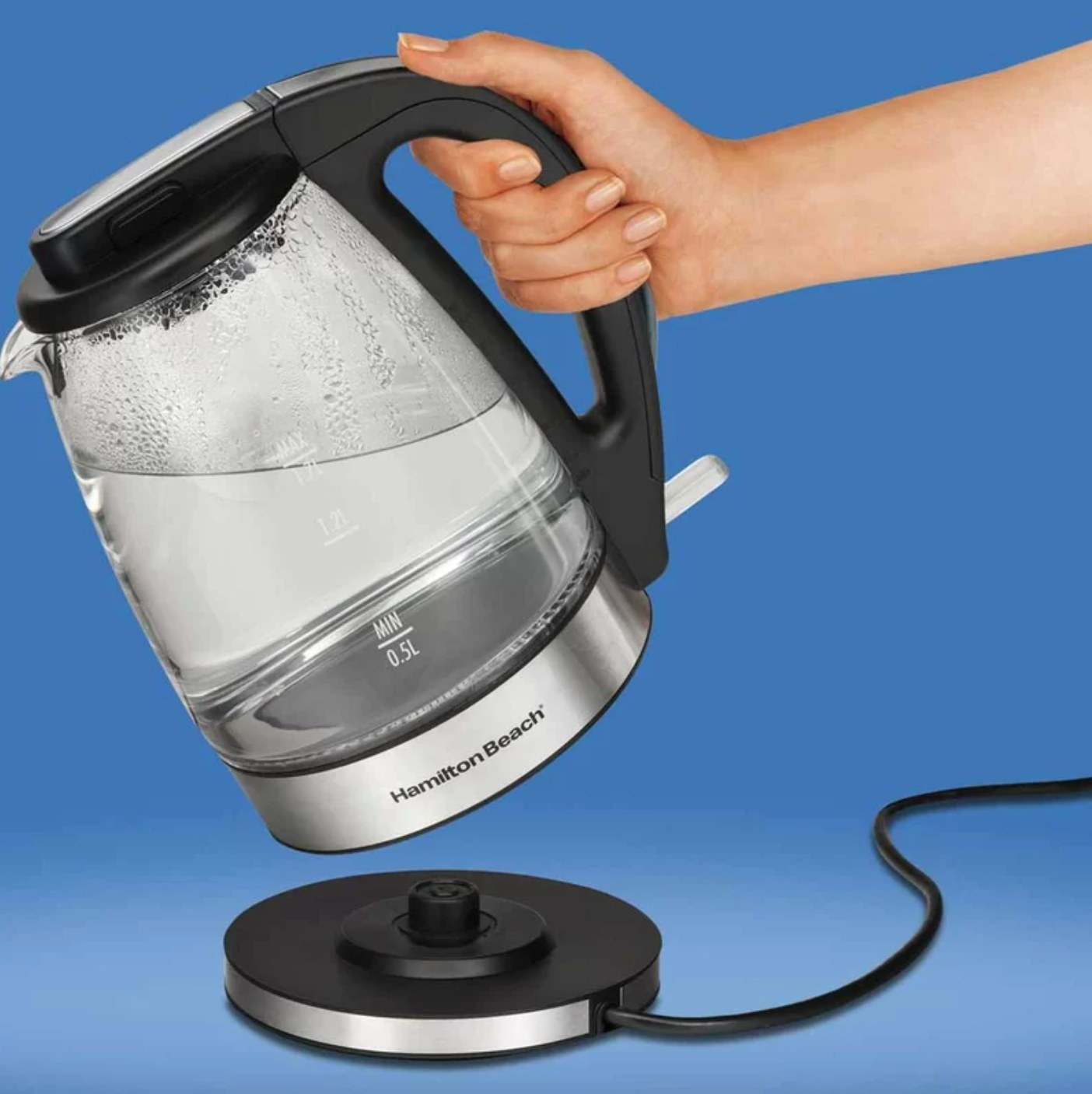 The glass electric kettle with a black charging stand