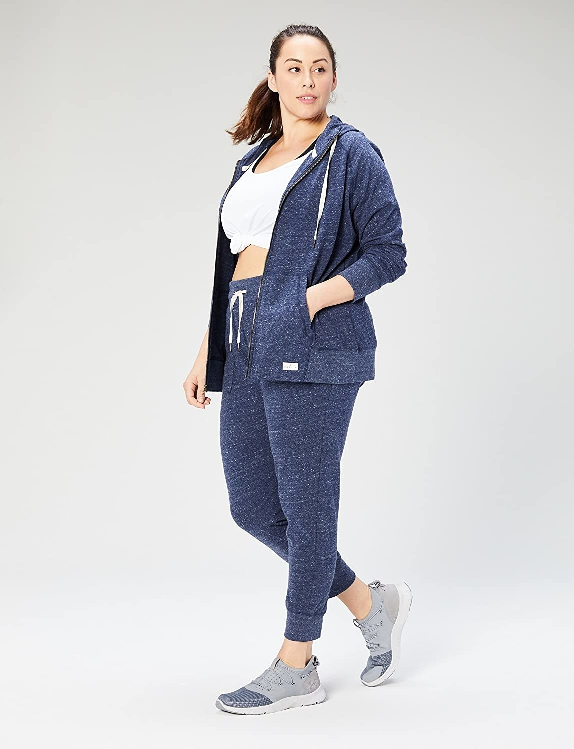 model wearing a full outfit with the joggers