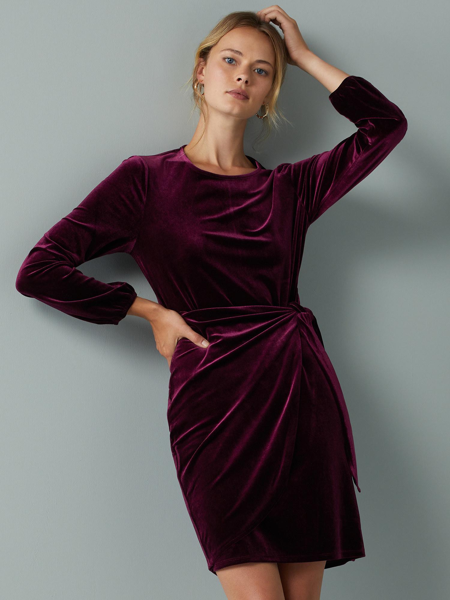 Model wearing velvet tie dress