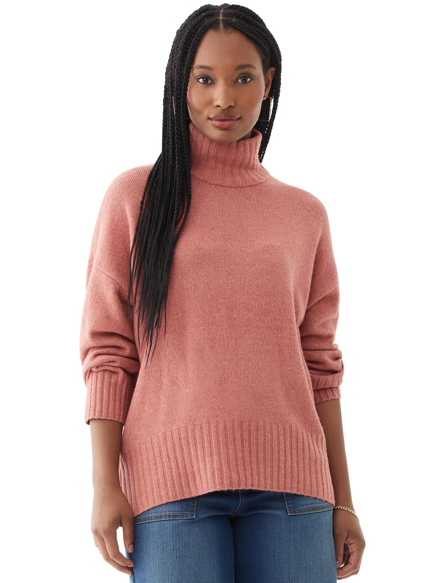 Model wearing pink sweater