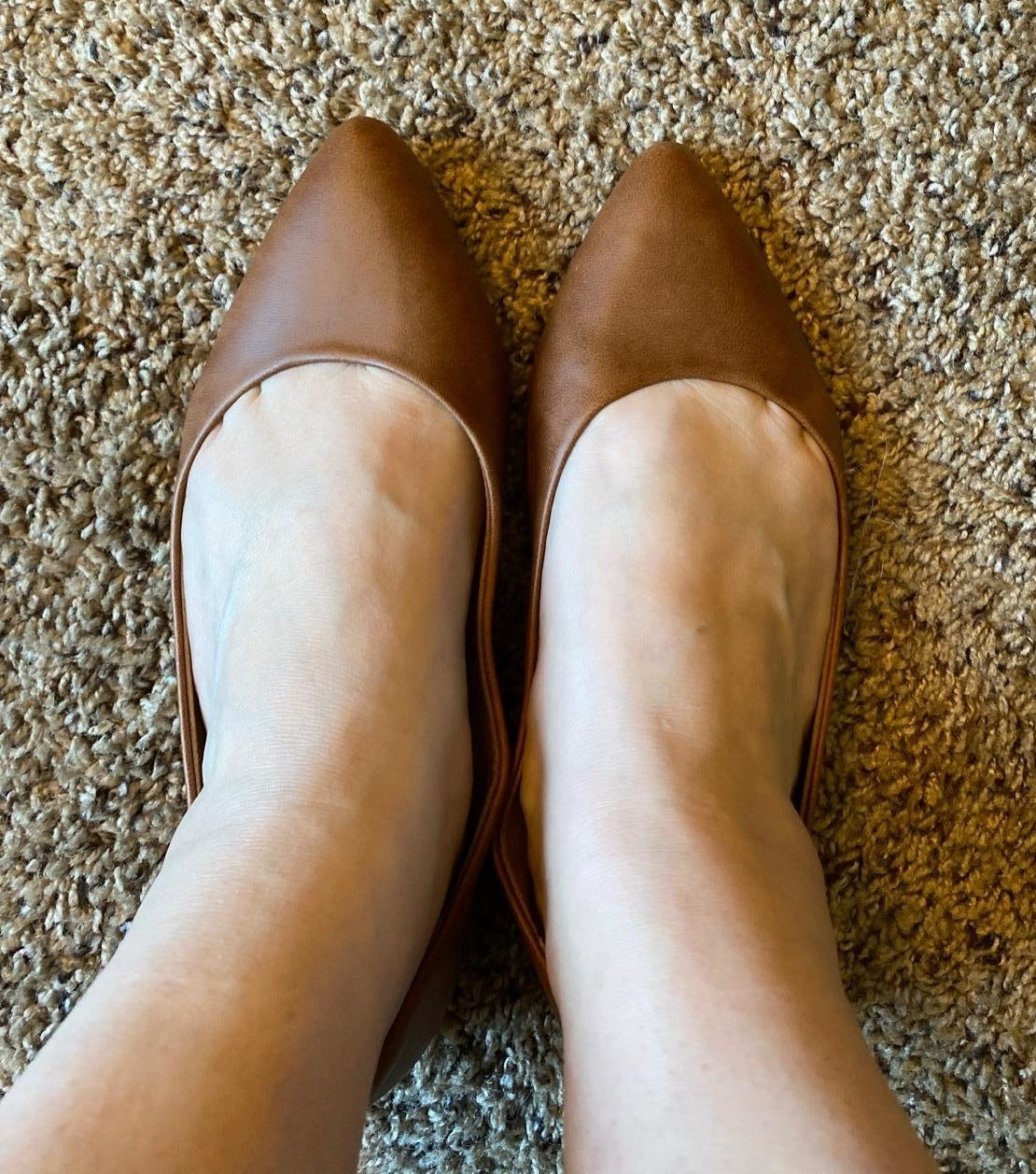 reviewer's wearing the brown flats