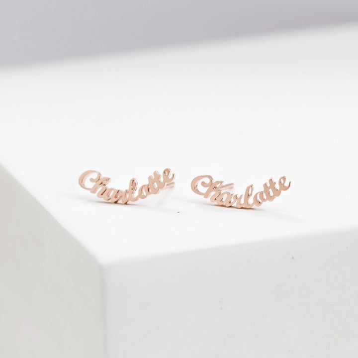 "two ""charlotte"" earrings"
