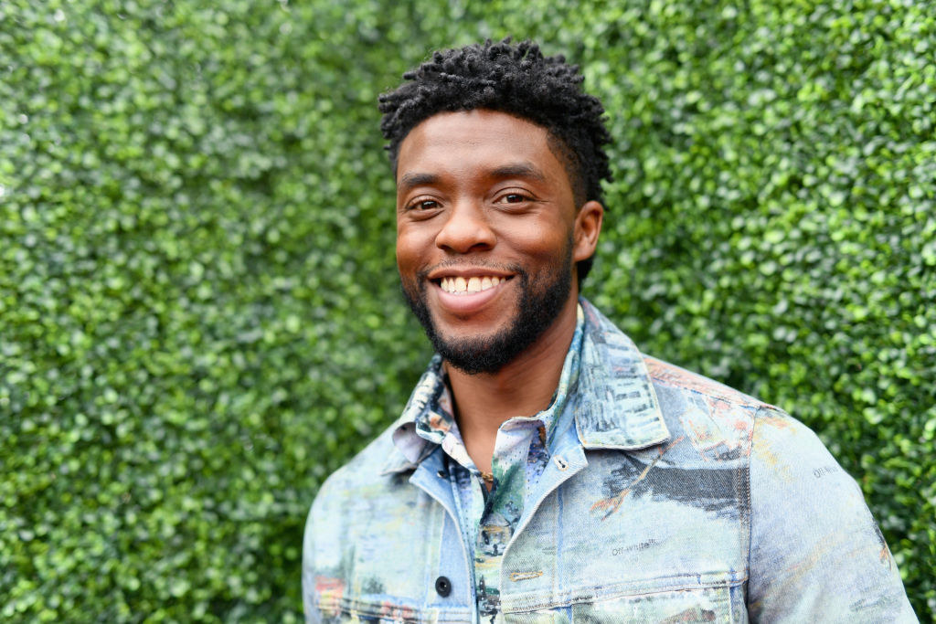 A smiling Chadwick in a jean jacket