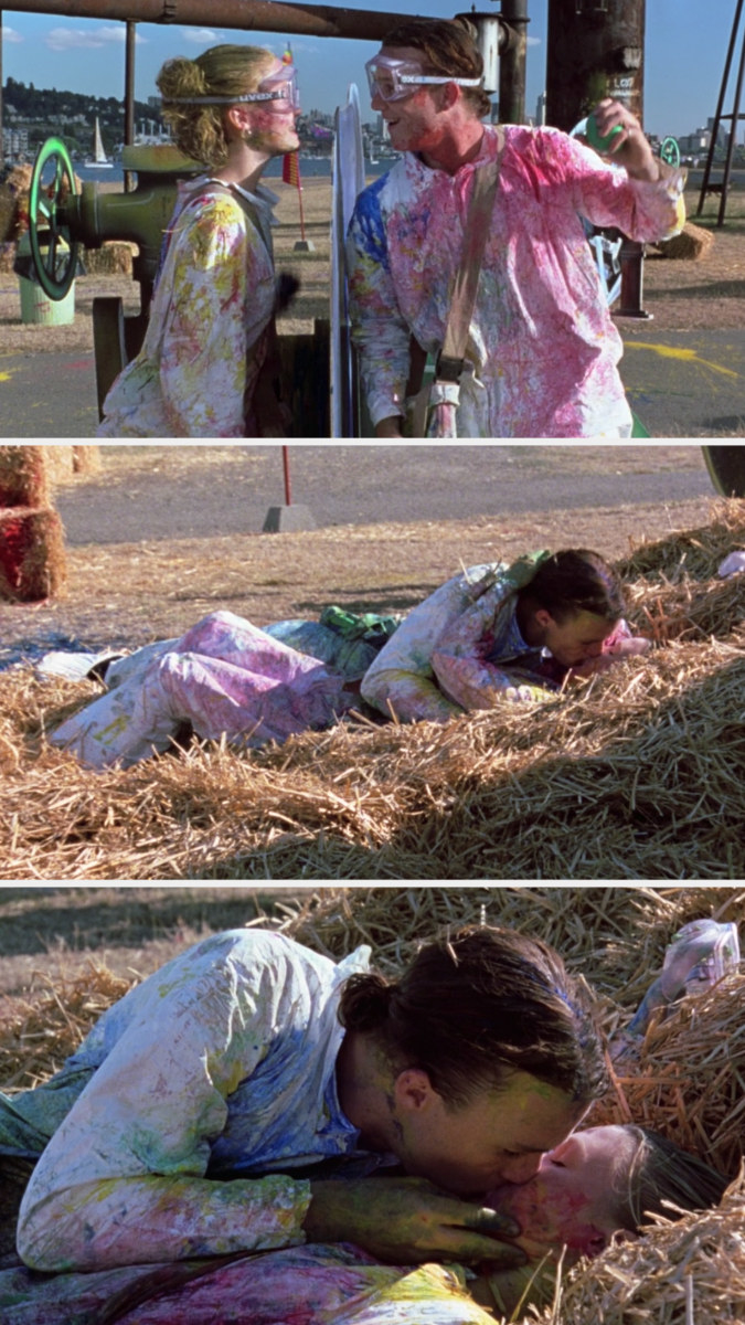 Kat and Patrick falling into the hay and kissing while covered in paint from their game