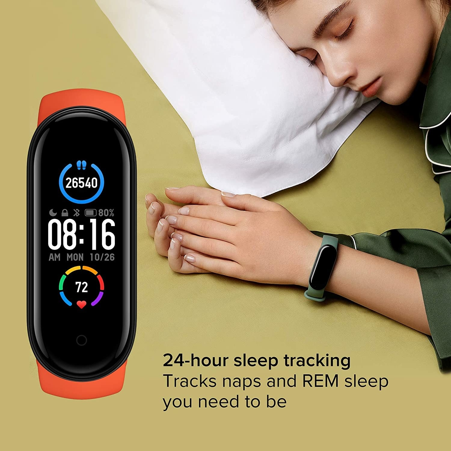 """A person sleeping while wearing their Mi band. Text reads: """"24-hour sleep tracking. Tracks naps and REM sleep you need to be."""""""