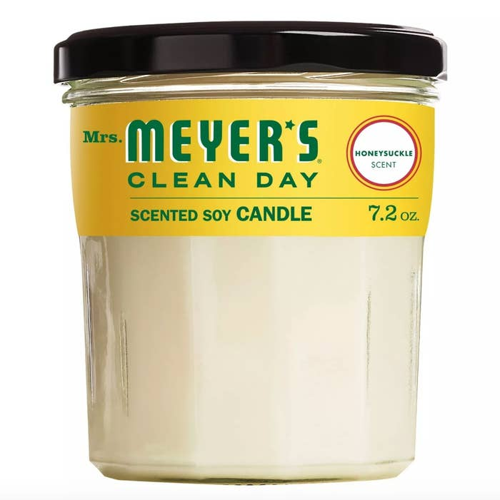The Mrs. Meyer's candle in honeysuckle with a yellow label