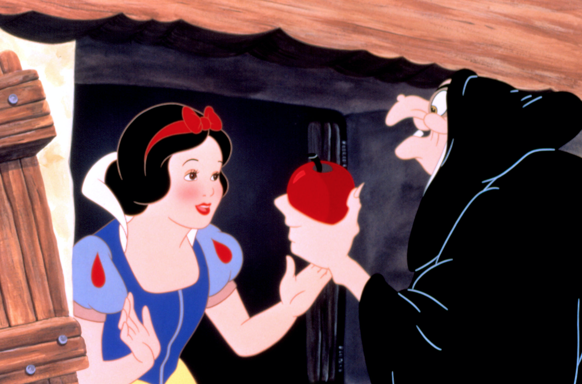 "Adriana Caselotti as Snow White and Lucille La Verne as the Queen / Witch in the movie ""Snow White."""