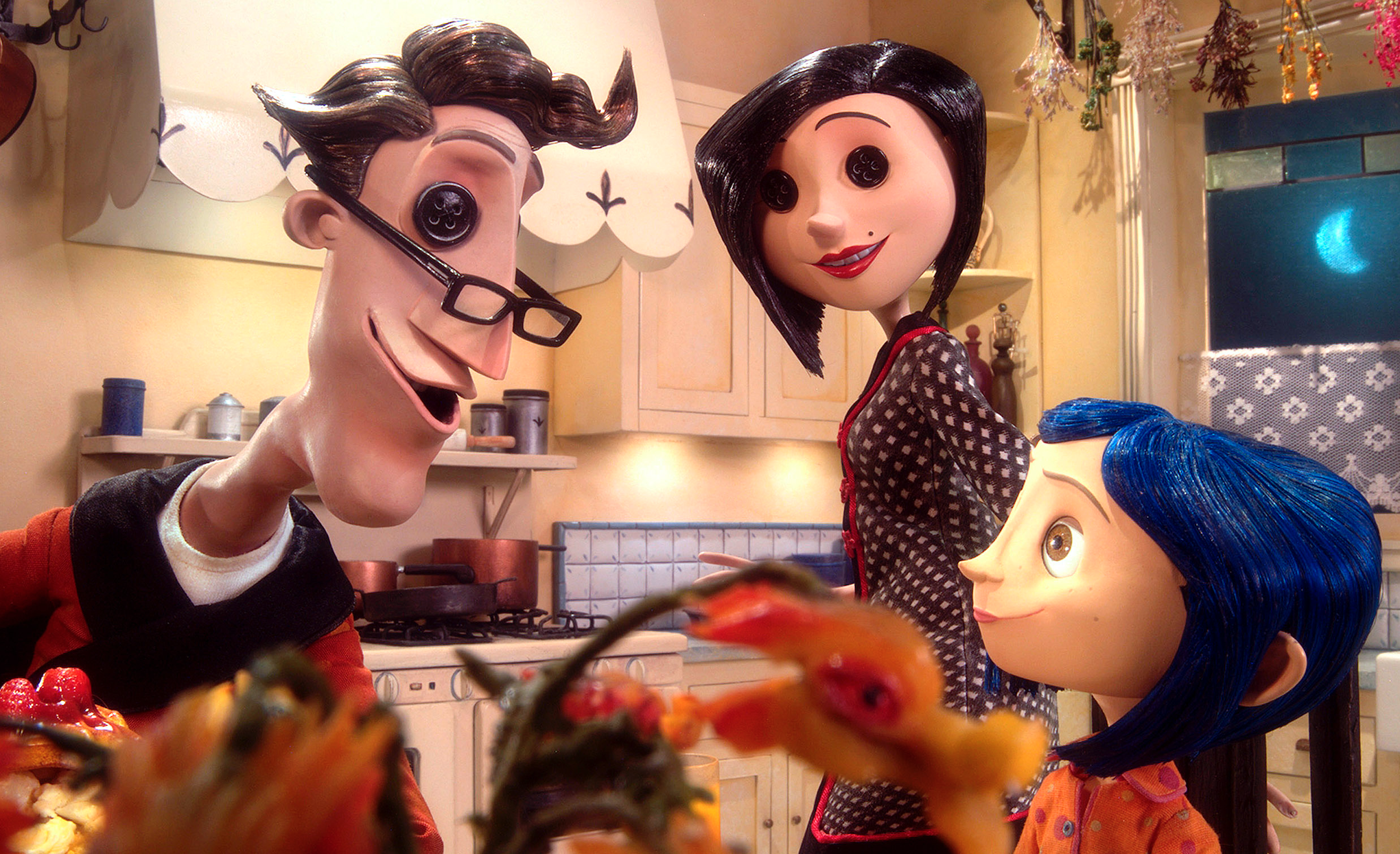 "Dakota Fanning as Coraline Jones, Teri Hatcher as Mel Jones, Coraline's mother, and the Beldam/Other Mother, and John Hodgman as Charlie Jones, Coraline's father, and as the Other Father in the movie ""Coraline."""