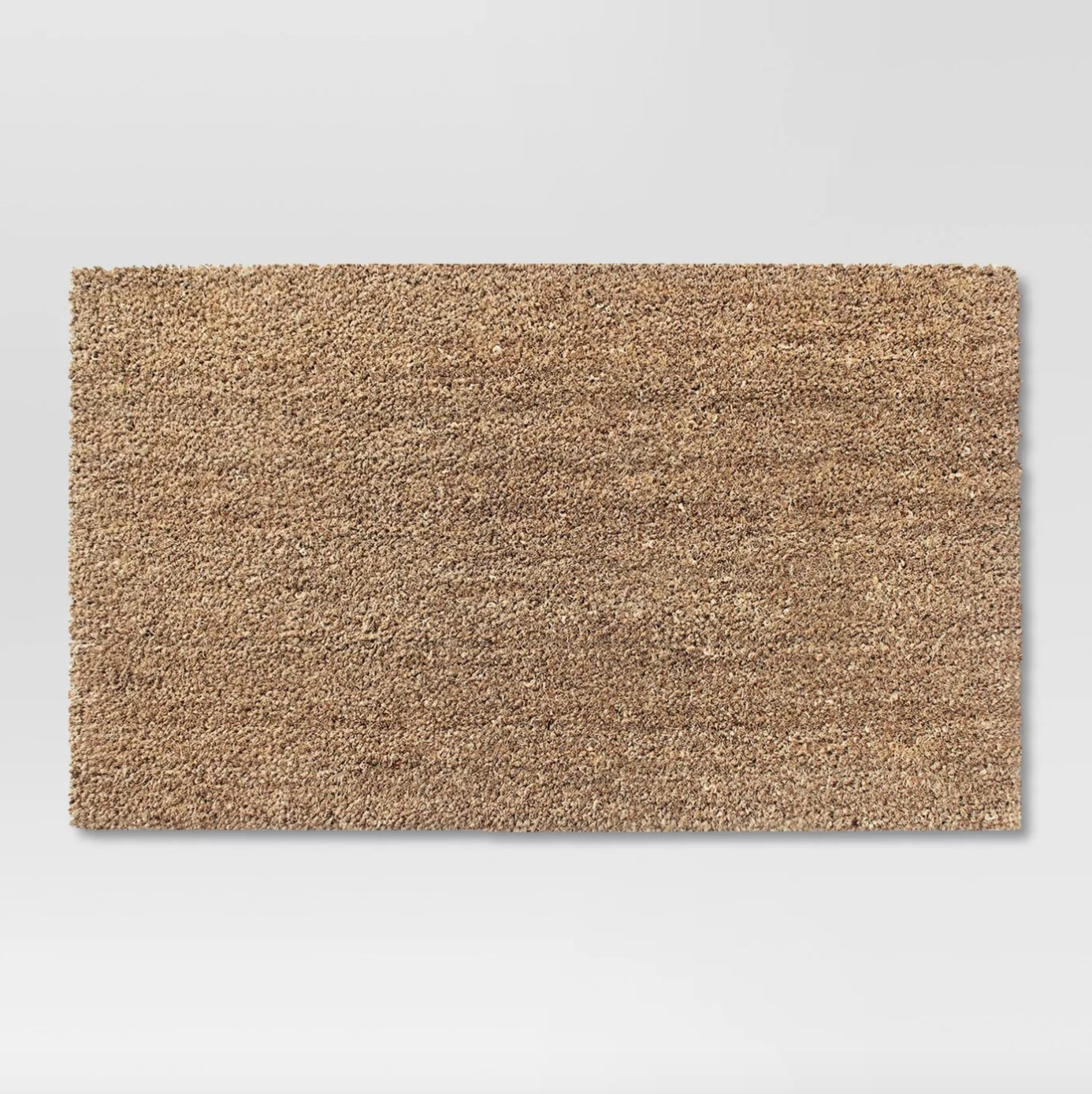 The solid doormat in beige