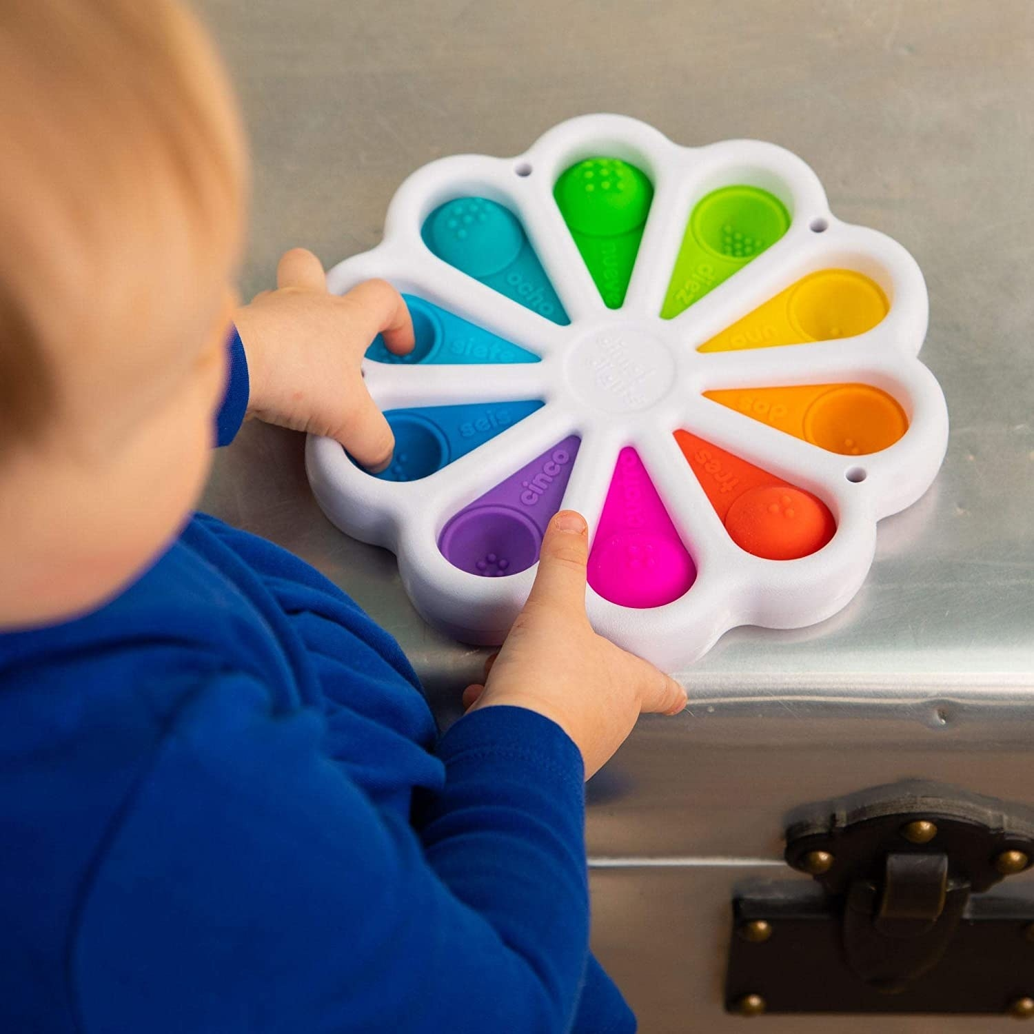 Child model playing with colorful wheel of Dimpl Digits