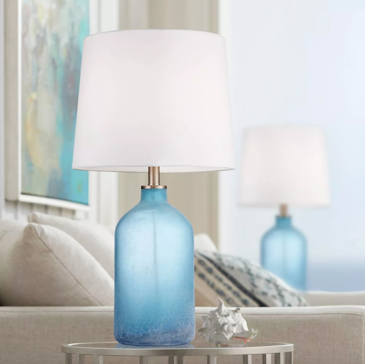 The set of two blue lamps with a glass base and white shade
