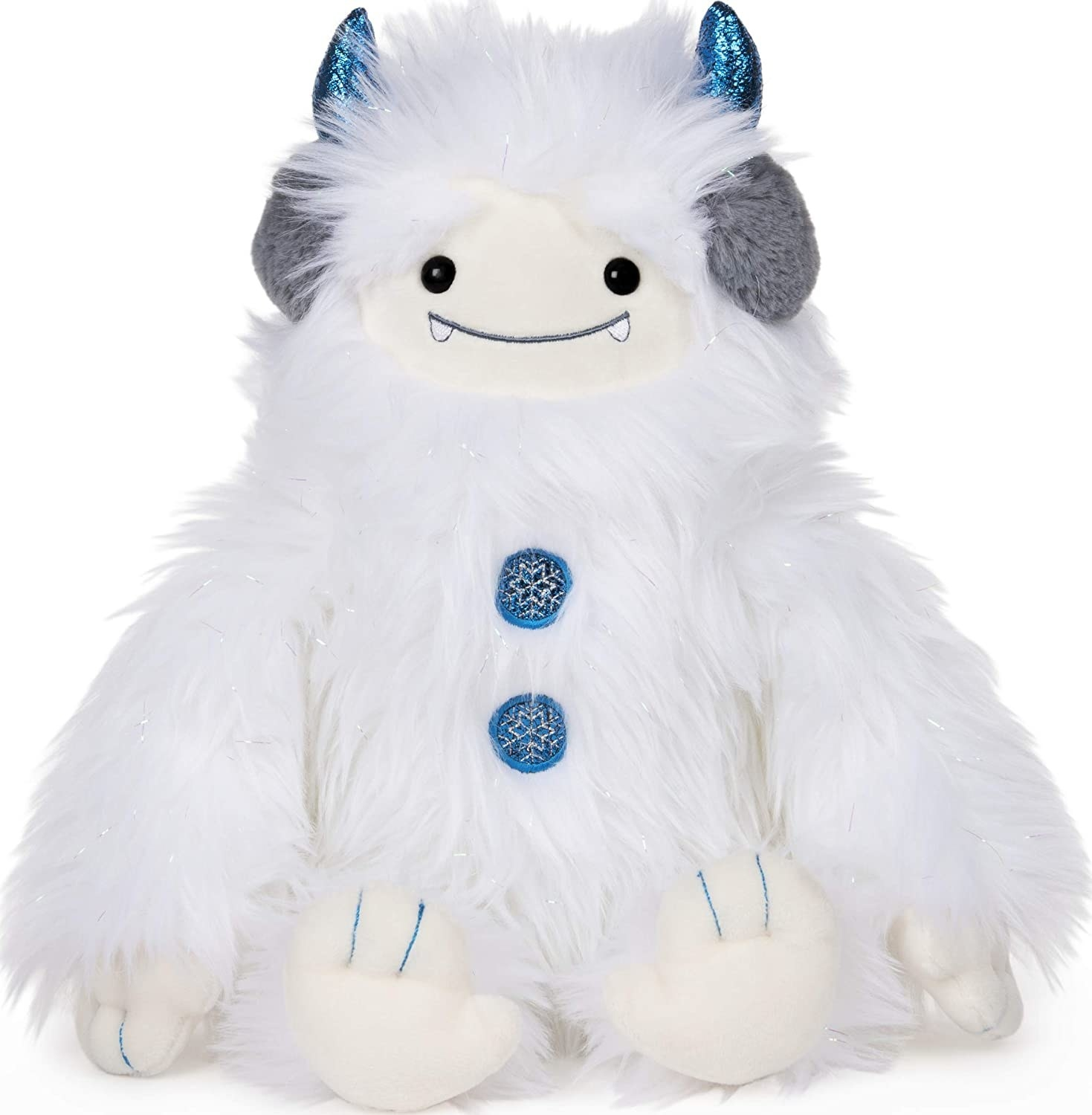 A furry white stuffed yeti doll with blue horns and buttons