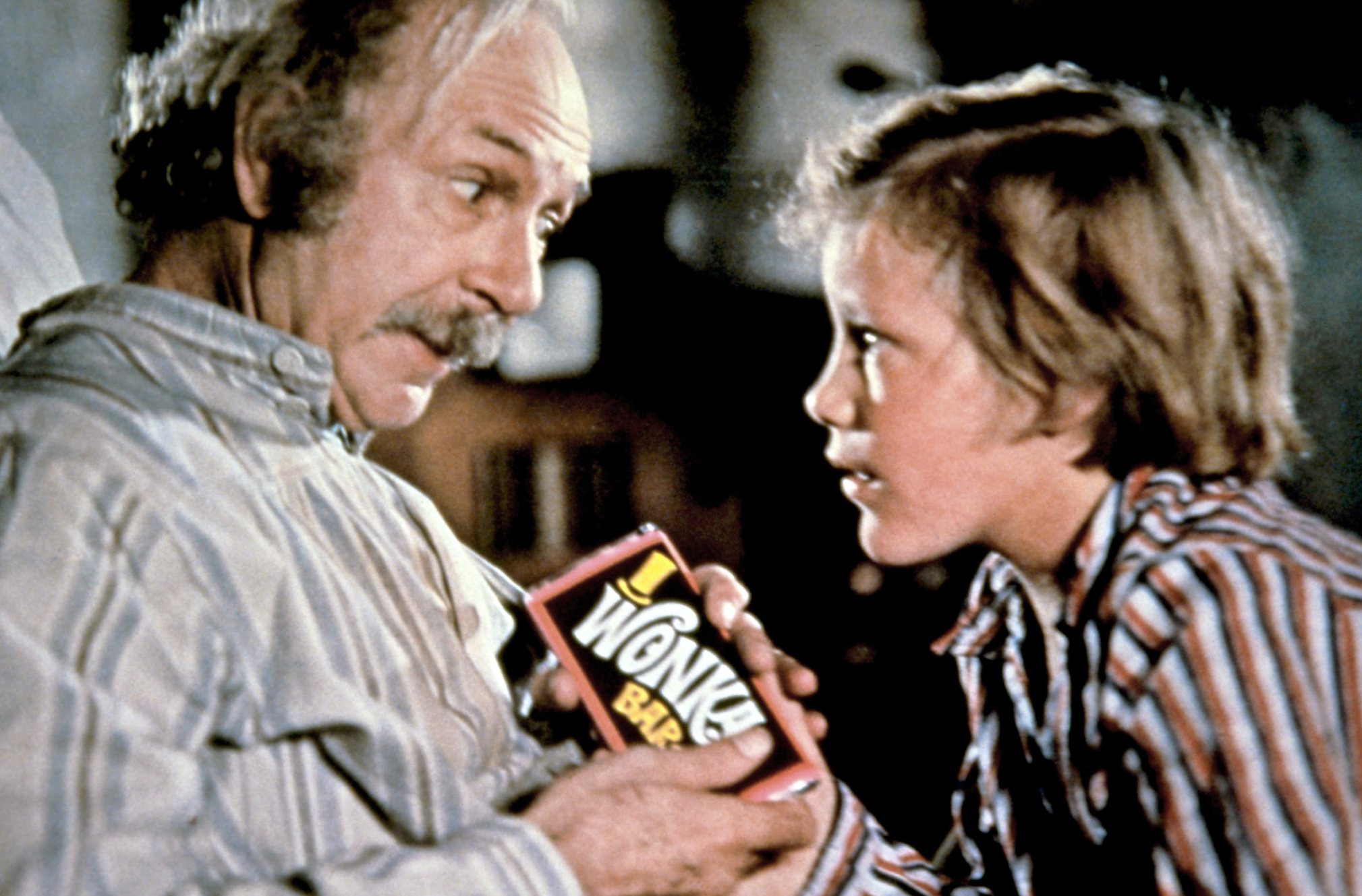 "Peter Ostrum as Charlie Bucket and Jack Albertson as Grandpa Joe in the movie ""Willy Wonka & the Chocolate Factory."""