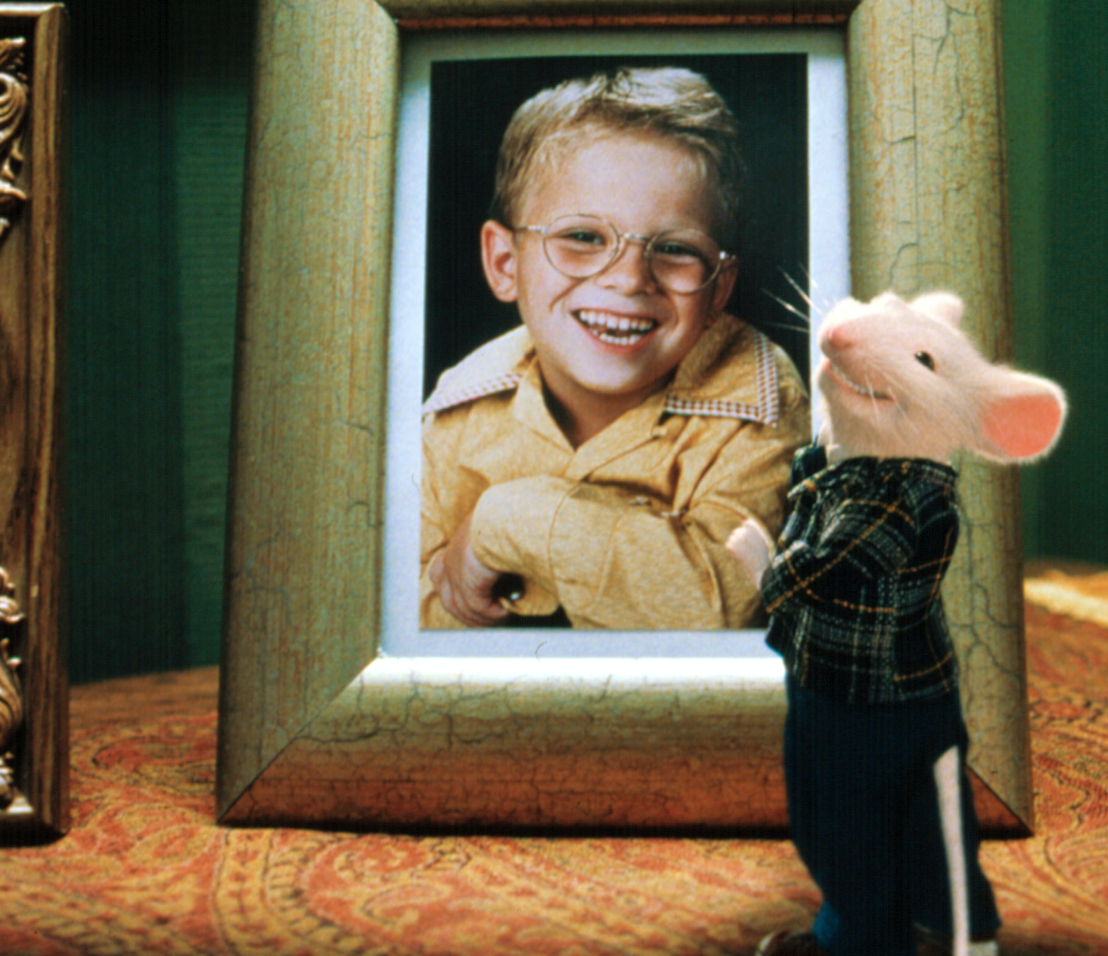 "Jonathan Lipnicki as George Little and Michael J. Fox as Stuart Little in the movie ""Stuart Little."""