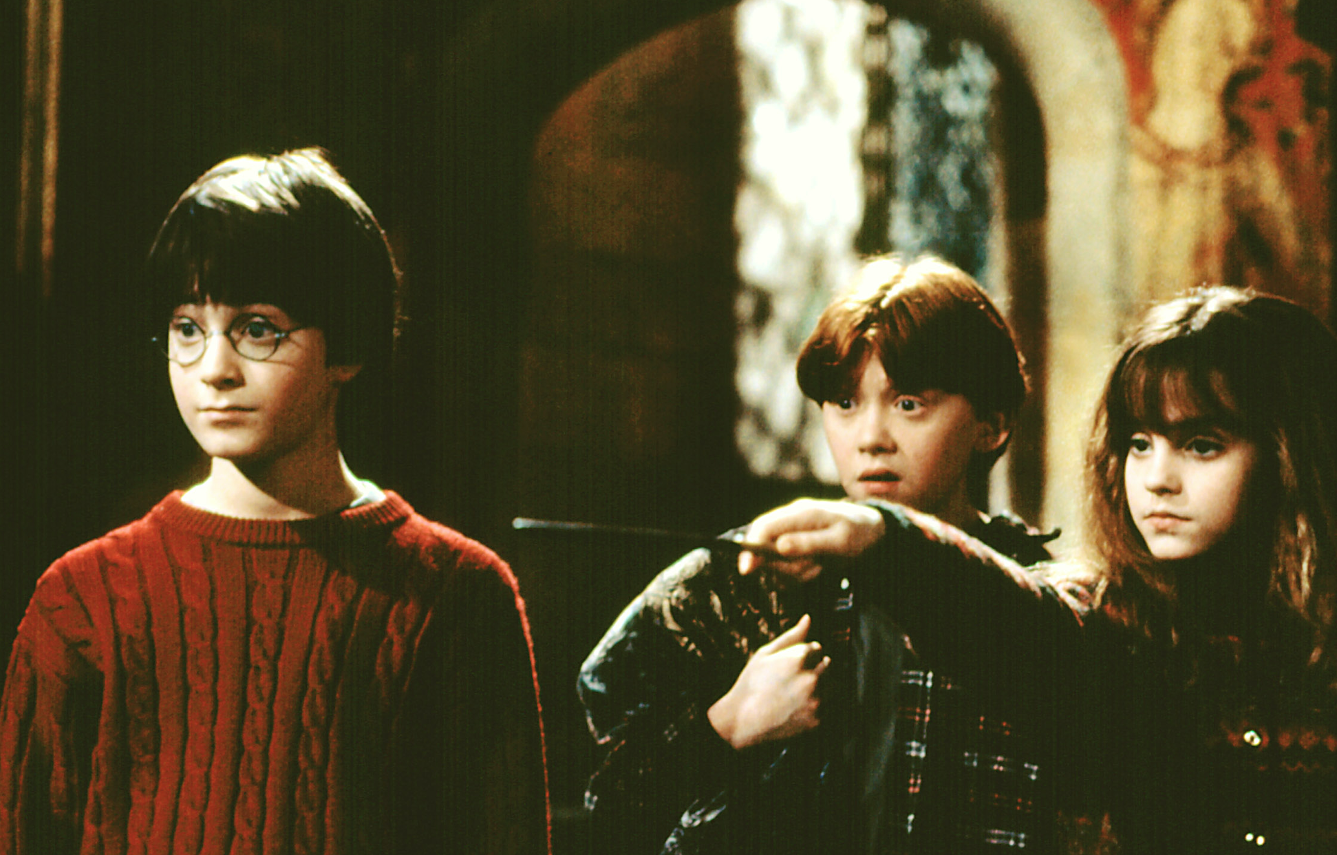 "Daniel Radcliffe as Harry Potter, Rupert Grint as Ron Weasley, and Emma Watson as Hermione Granger in the movie ""Harry Potter and the Sorcerer's Stone."""