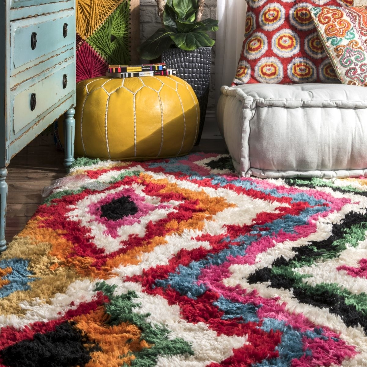 A thick shag rug with multiple bright colors in diamond patterns