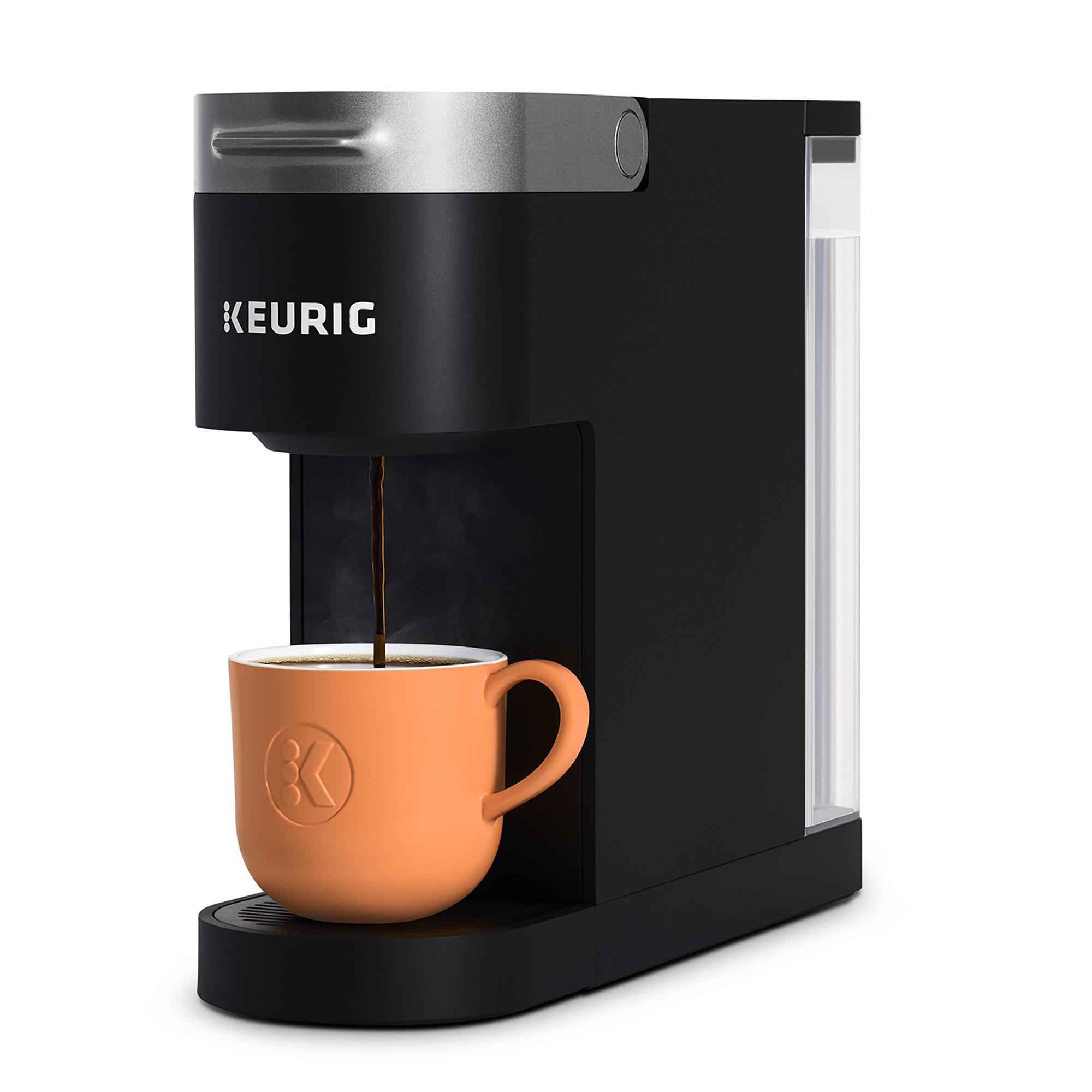 keurig coffee maker pouring coffee into an orange coffee mug