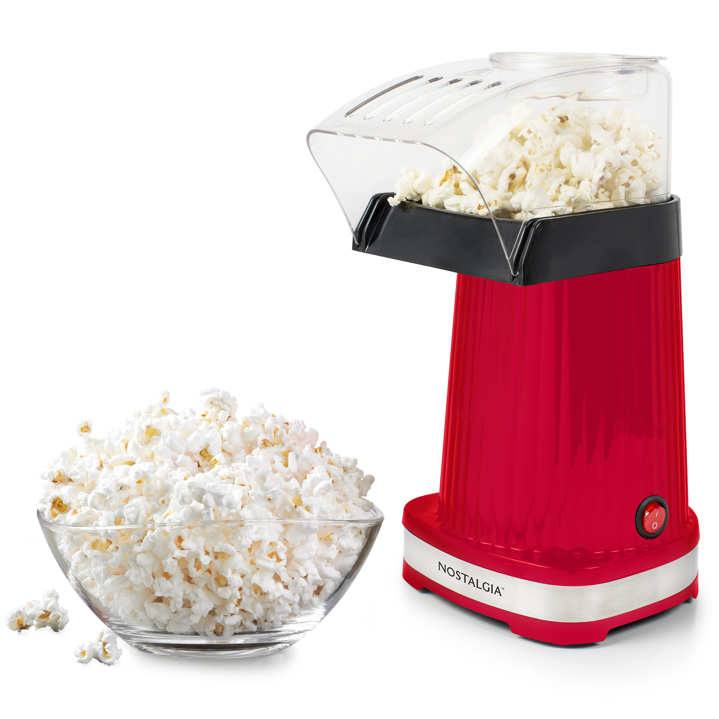 red nostalgia popcorn maker with popped popcorn in a bowl in front of it