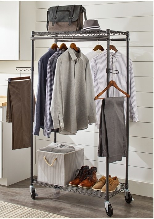 gray rolling garment rack with clothes and shoes on it
