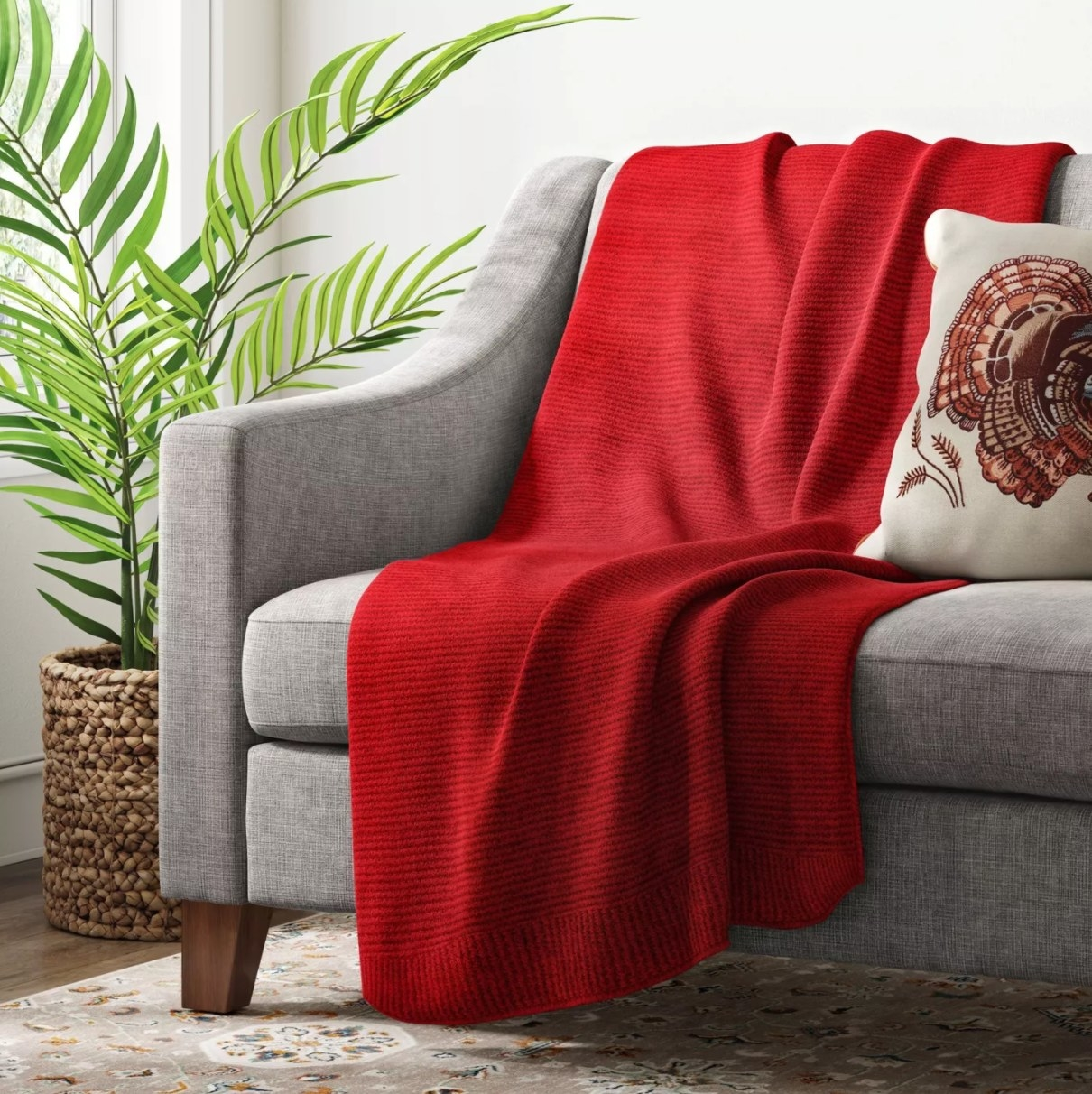 The knit throw blanket in red