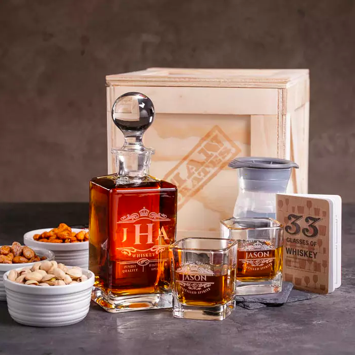 the whiskey crate with whiskey, glasses, and nuts