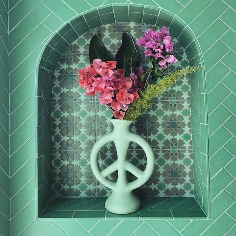 The vase shaped like a peace sign in teal