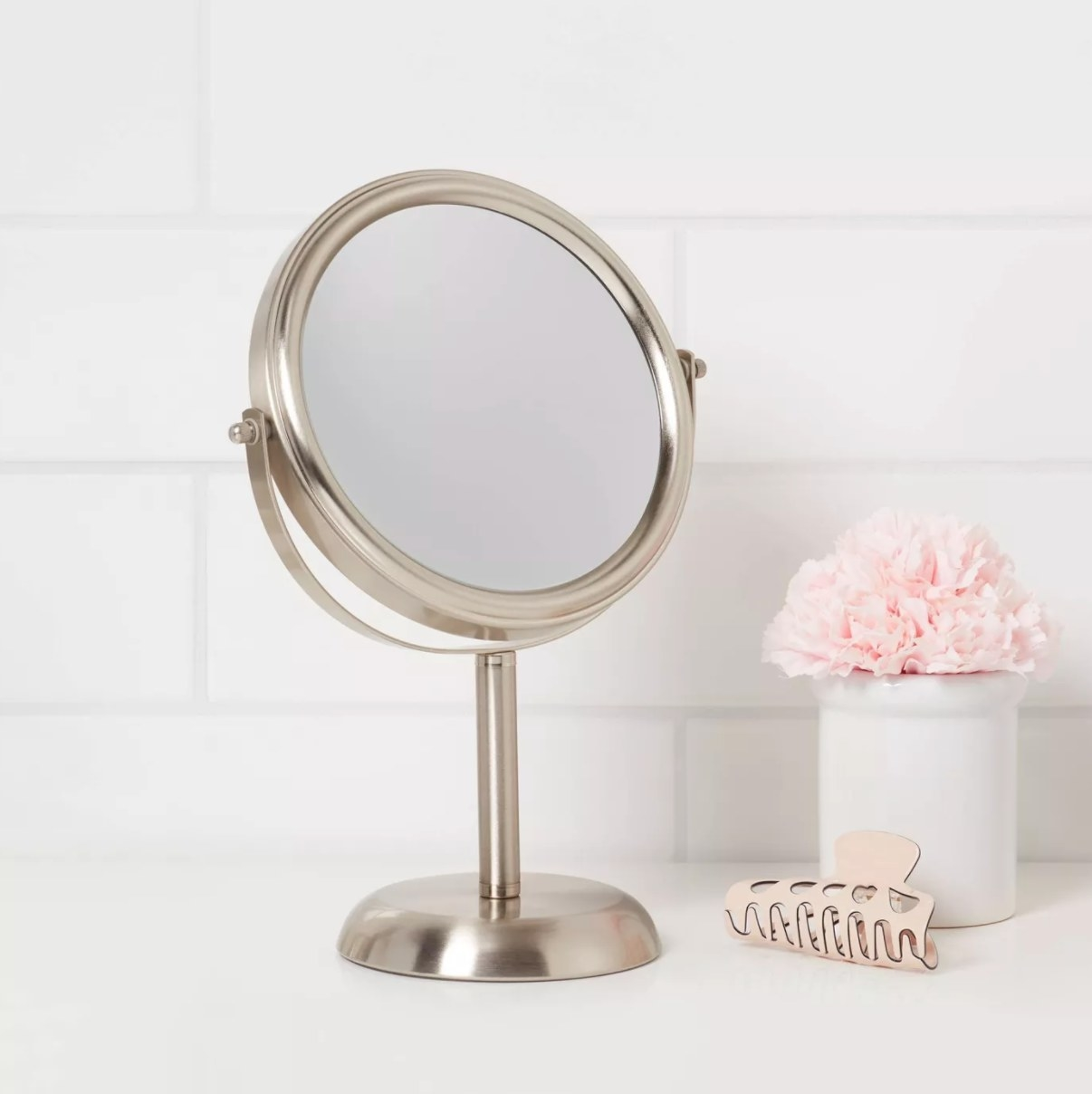 The bathroom mirror in brushed nickel