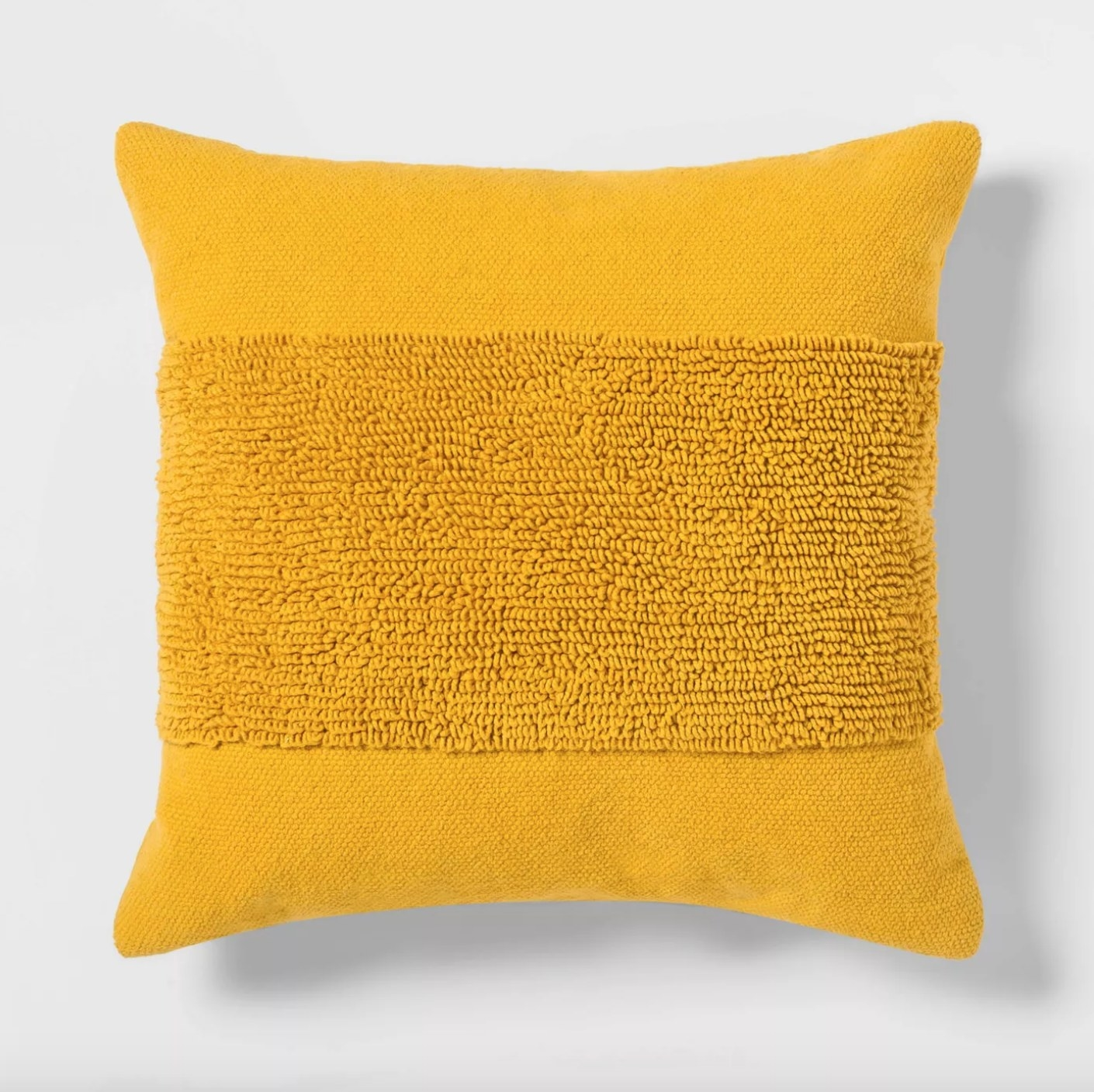 The tufted square throw pillow in yellow