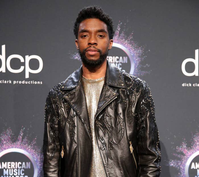 Chadwick Boseman poses in the press room during the 2019 American Music Awards