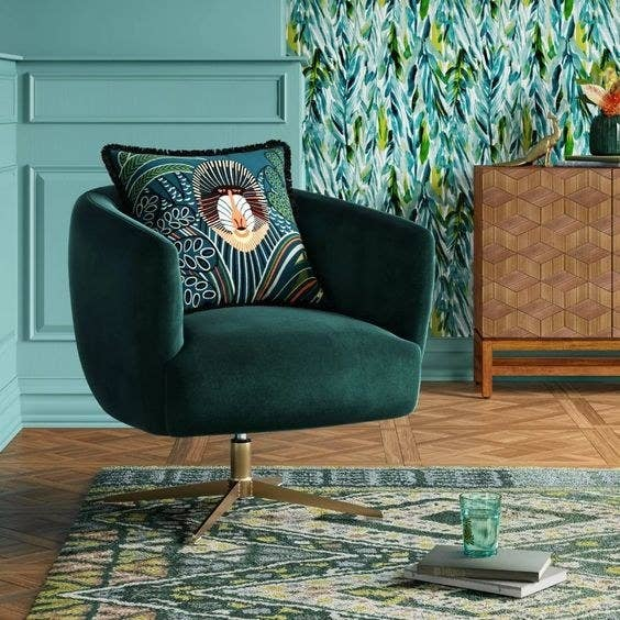 The rolling velvet chair in emerald green