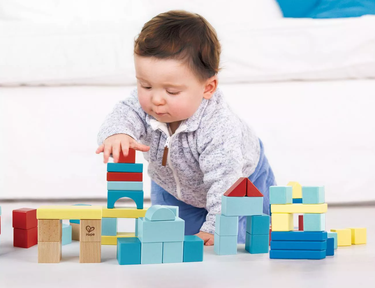 Child model playing with colorful building blocks