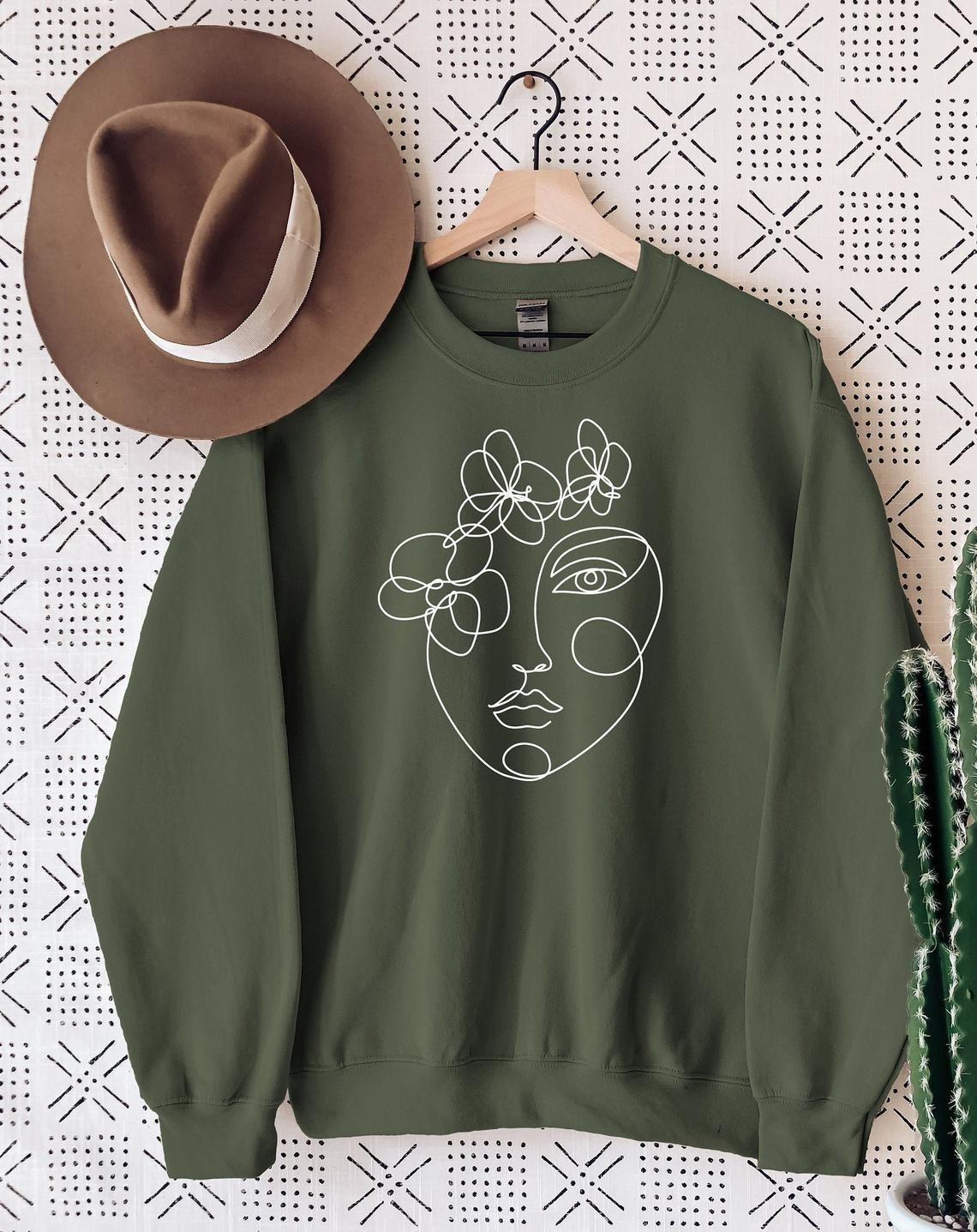 Olive green sweatshirt with face