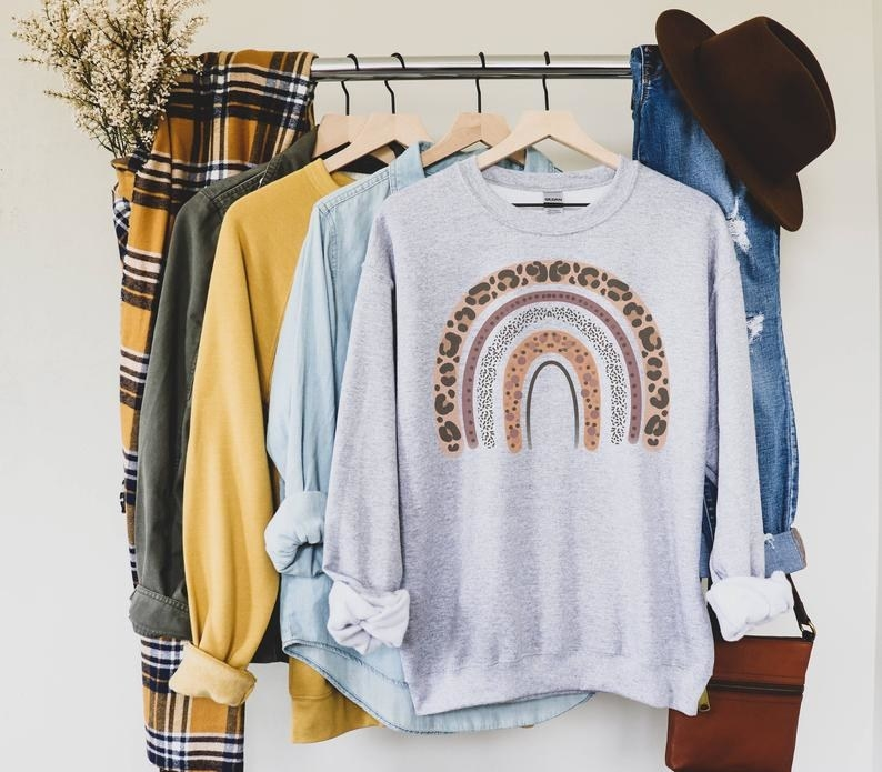 a gray sweatshirt with simple rainbow arch in different leopard prints
