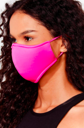 A person wears a face mask with elastic at the ears