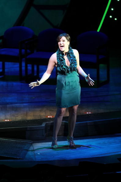 Shoshana Bean as Elphaba performing onstage for a Broadway benefit performance