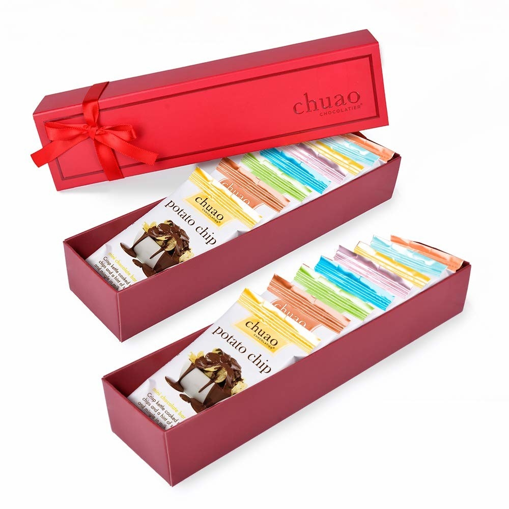 Two rectangular red gift boxes with eight mini chocolate bars each
