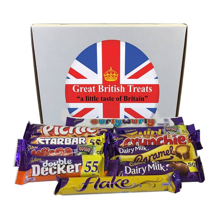 "A box that says ""Great British Treats"" along with full-sized Cadbury chocolate bars in a variety of flavors"