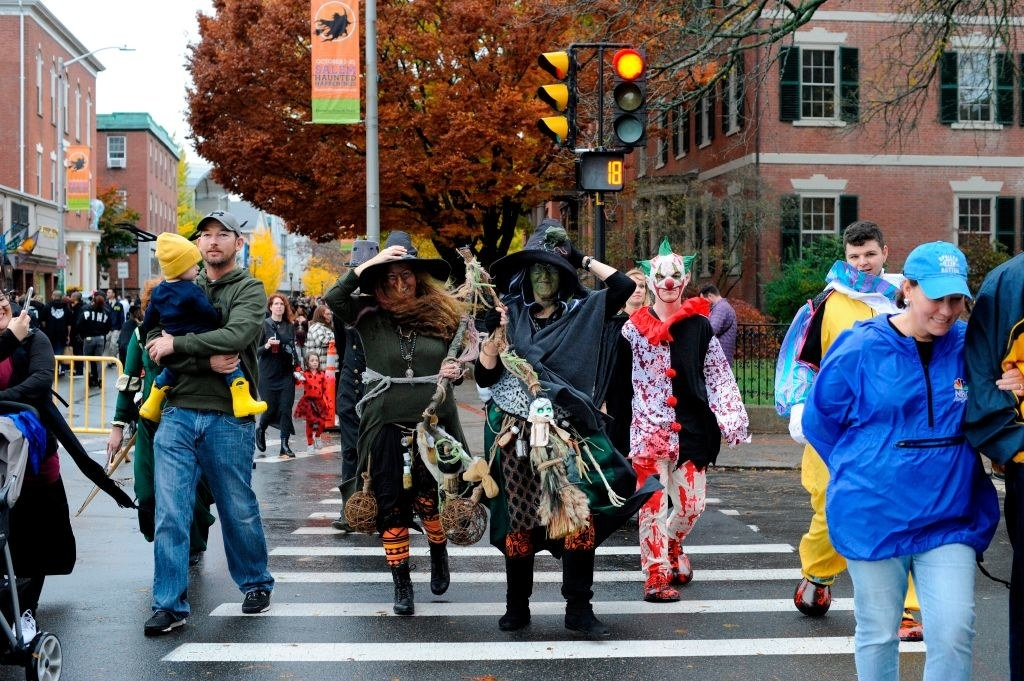 People walk the streets in costume during Halloween on October 31, 2019 in Salem, Massachusetts