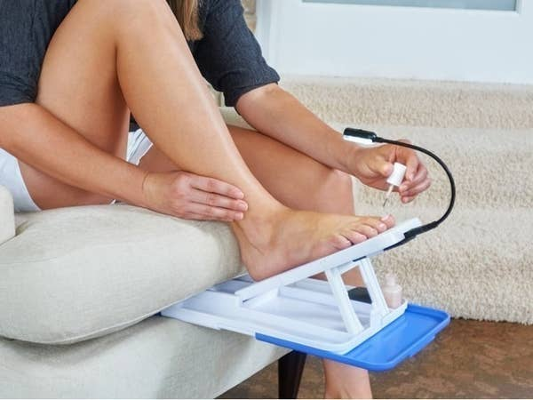 A person giving themselves a pedicure at home using the Stedi Pedi