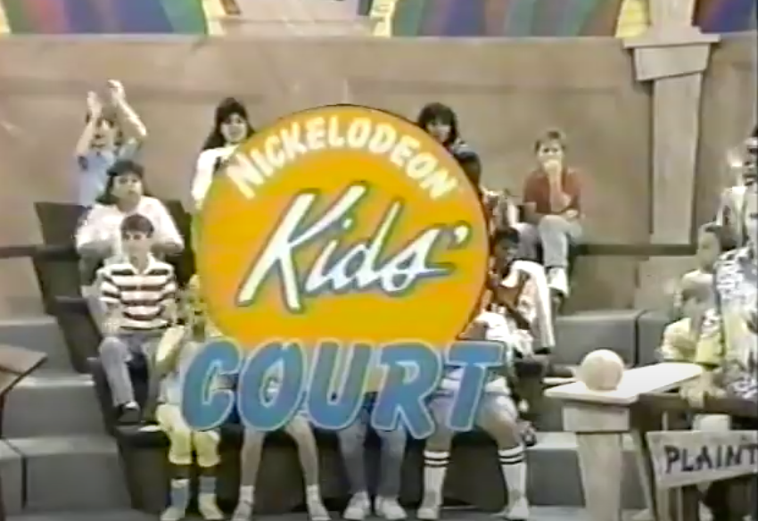 """The logo for """"Nickelodeon Kids' Court"""" with kids sitting in the audience in the background"""