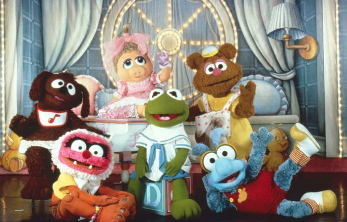 Promotional photo of performers dressed as Rowlf, Animal, Piggy, Kermit, Fozzie, and Gonzo from Muppet Babies