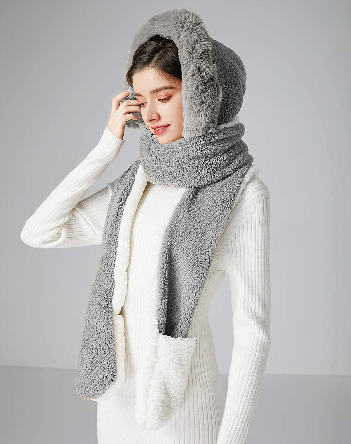 A model wears the grey and white Bellady Soft Winter Warm Hooded Scarf