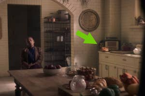 a hidden ghost child in the background of a scene with Hannah sitting in the kitchen in The Haunting of Bly Manor