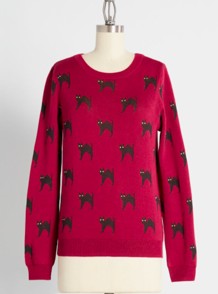 A sweater with black cats