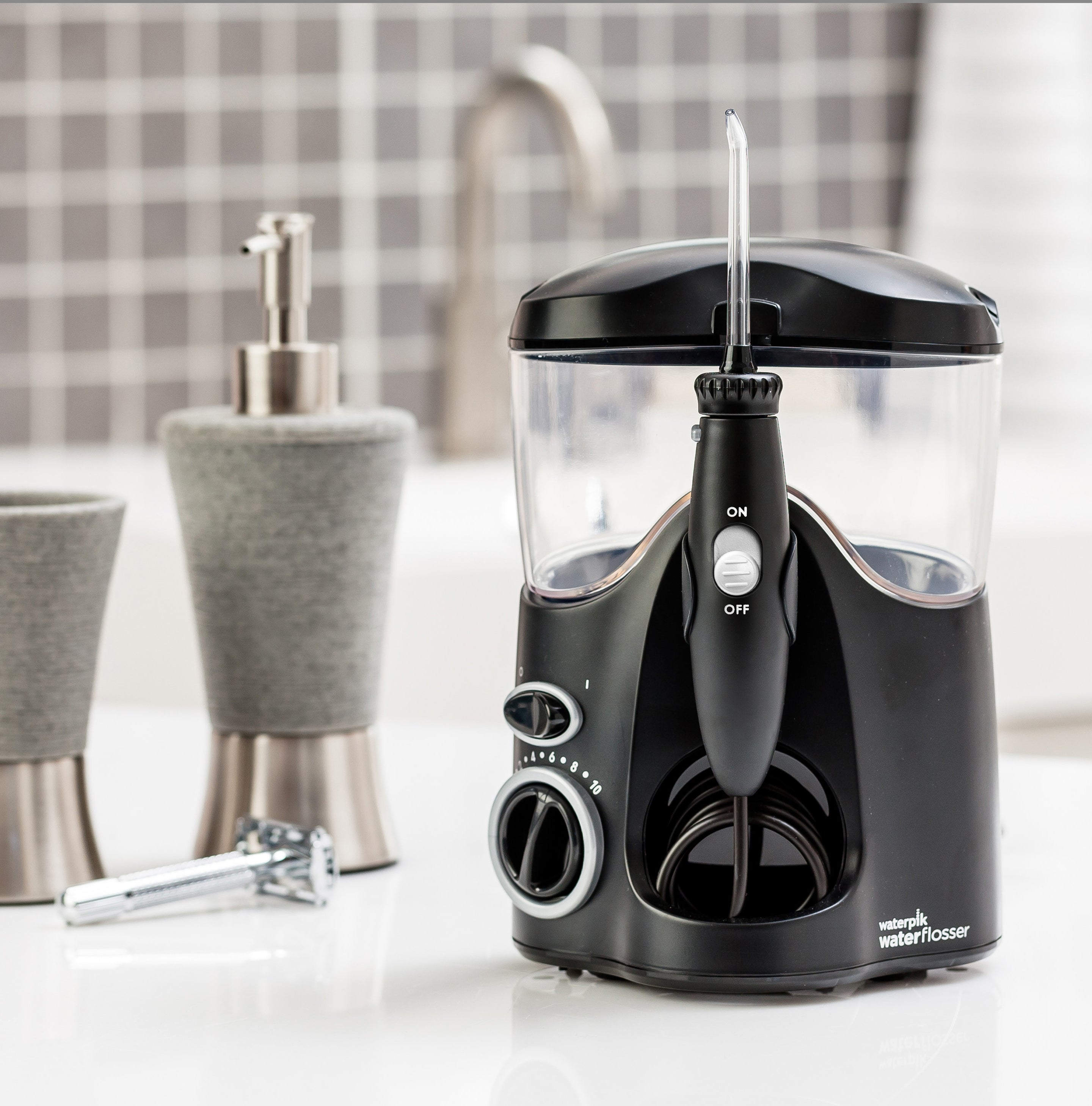black water flosser sitting on top of a bathroom counter