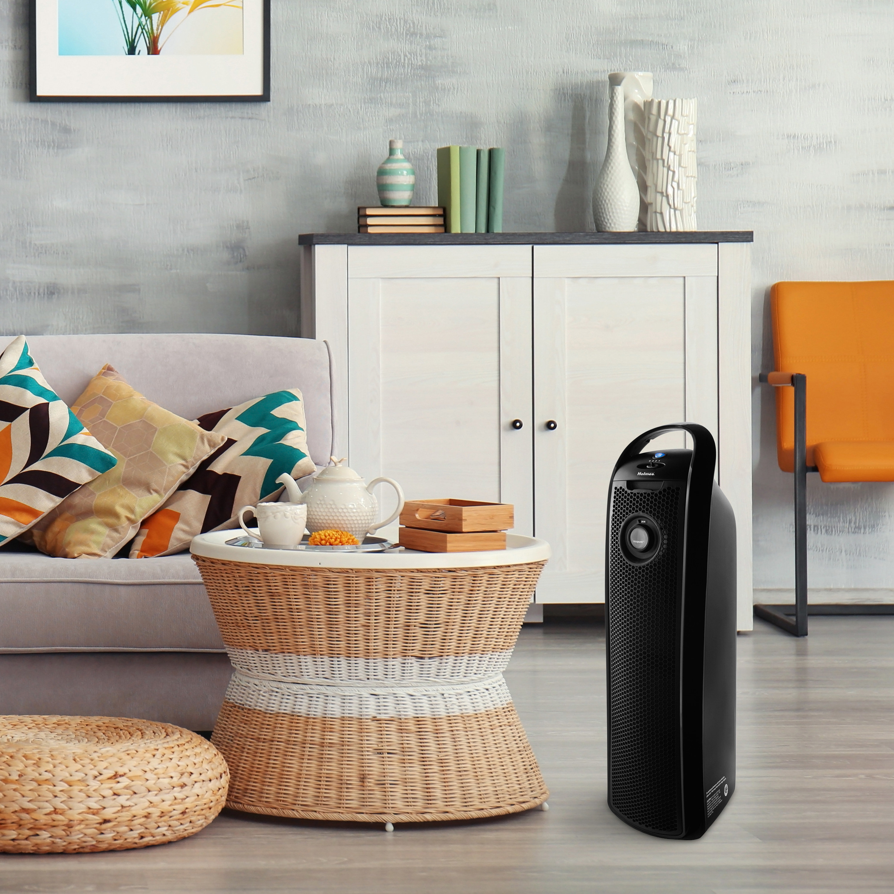 black air purifier inside a living room with bright furniture