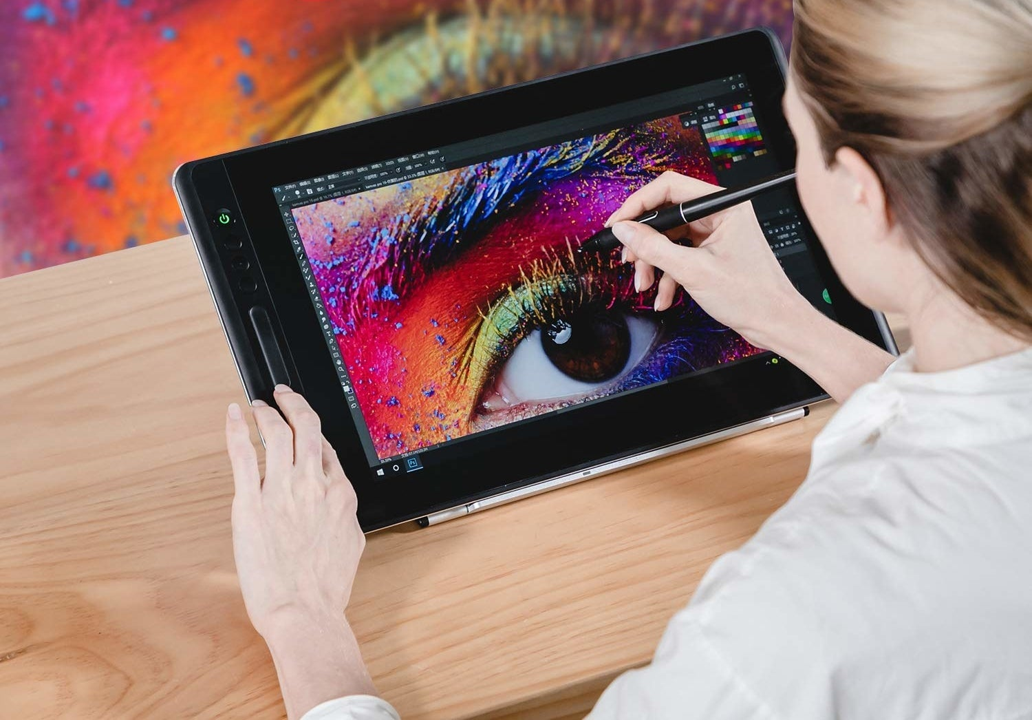 A person working on art on their tablet.